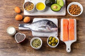Foods that help you become fat adapted, such as fish, nuts. eggs. olives, and avocados