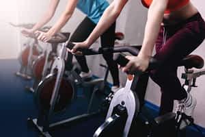 fit women on exercise bikes