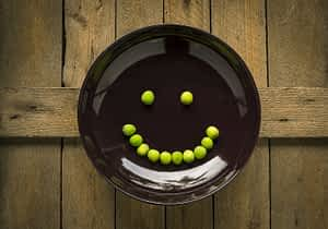 peas on plate smiley face