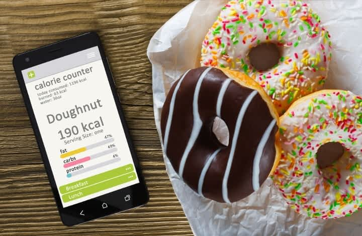 phone app for counting calories next to donuts