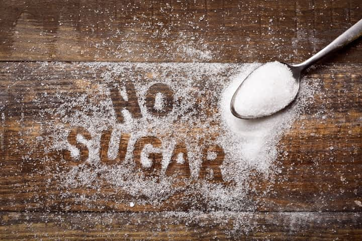 """No Sugar"" written in granules of refined white sugar"