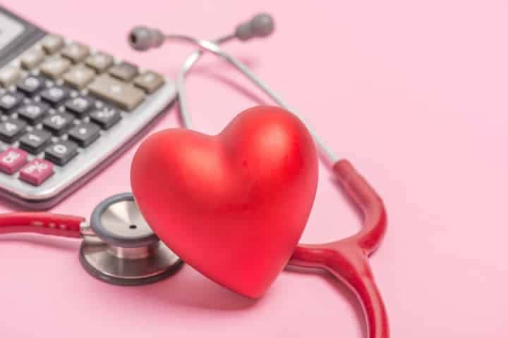 heart, stethoscope, and calculator for figuring out heart rate