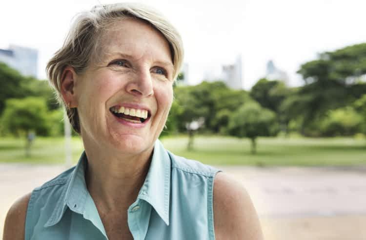 Smiling older woman in park