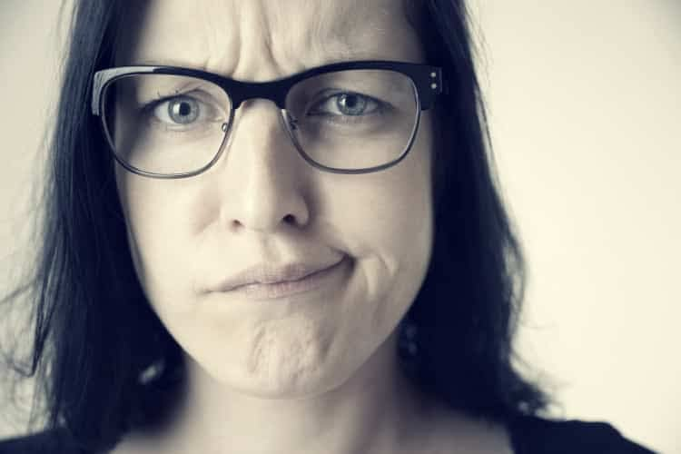 Perplexed-looking woman with glasses